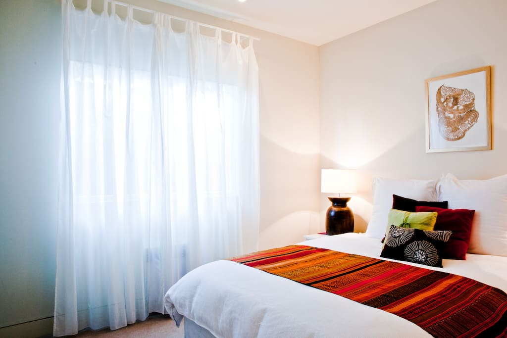 Sunny, beautiful bedroom.