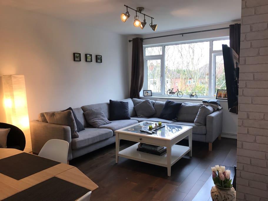 Living room. Large comfy sofa and flat screen TV.