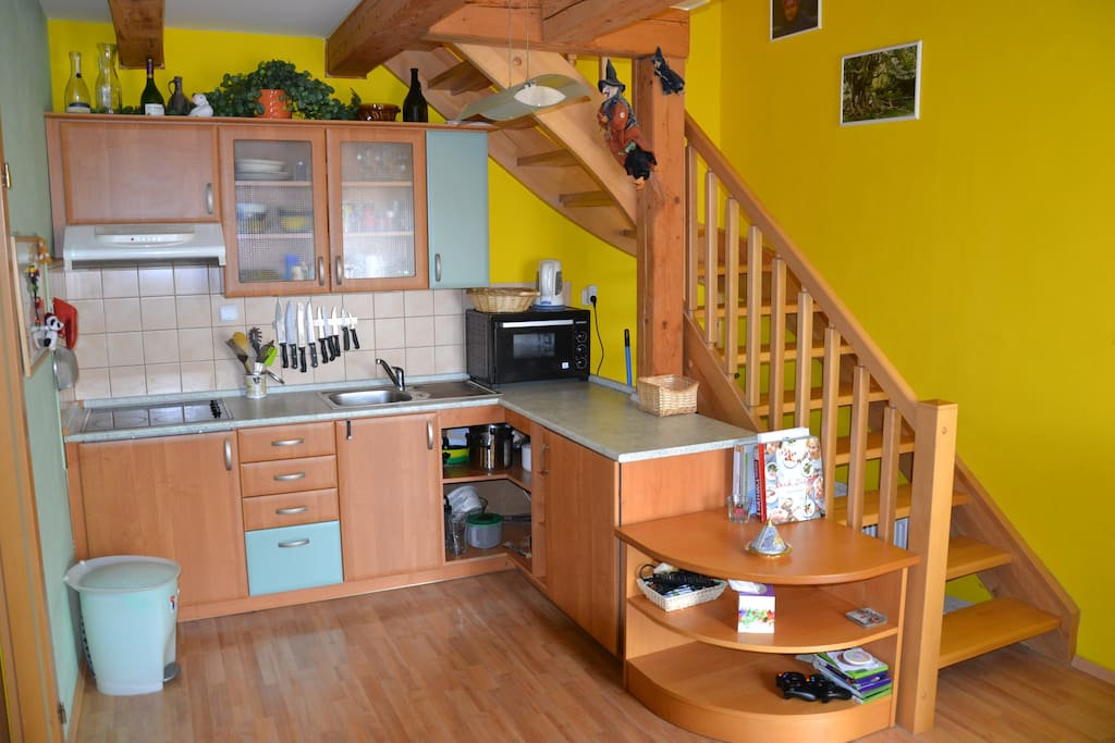 Fully equipped kitchen with the stairs to the upper floor