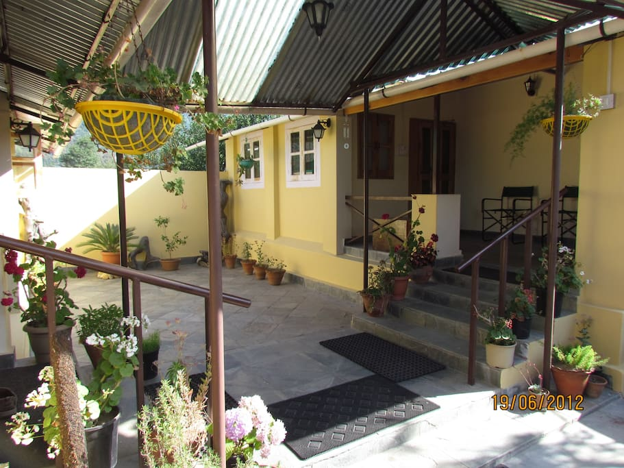 Two cozy identical huts with meshed verandahs and a courtyard