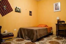 Room # 4 Shared bathroom with hot shower and good WiFi. variety of amenities and work area with good WiFi