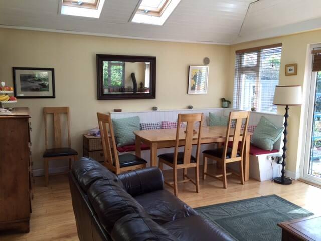Bright Dining area in the Sunroom.