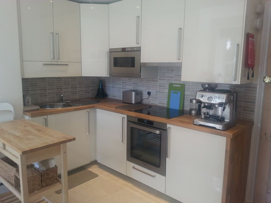 Fully equipped kitchen including washer/dryer, microwave, hob, full sized oven and fridge.