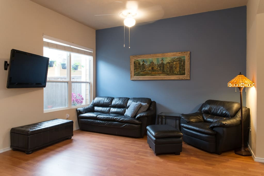 Open living room with cozy seating and new television-access to Netflix.