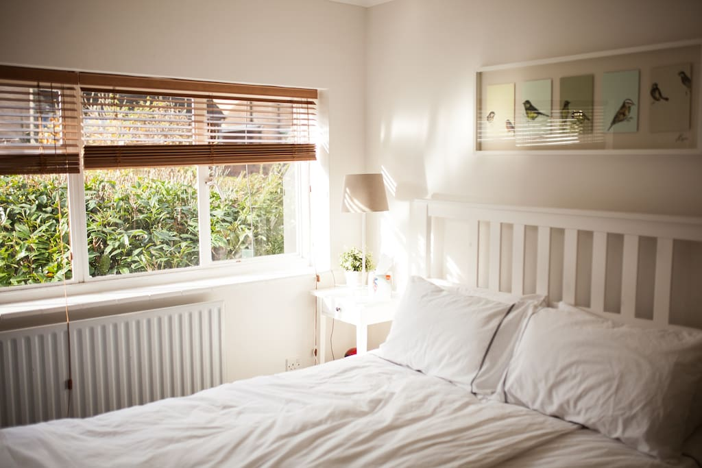 Second master bedroom with King size bed, with shades