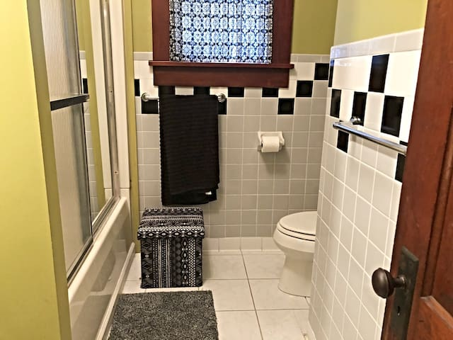 A clean and  comfortable bathroom with  hot showers and clean towels.