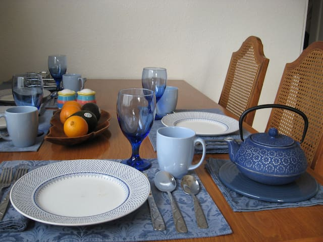 Plenty of dishes, tea kettle, coffee maker, pots and pans, placemats, table cloths.