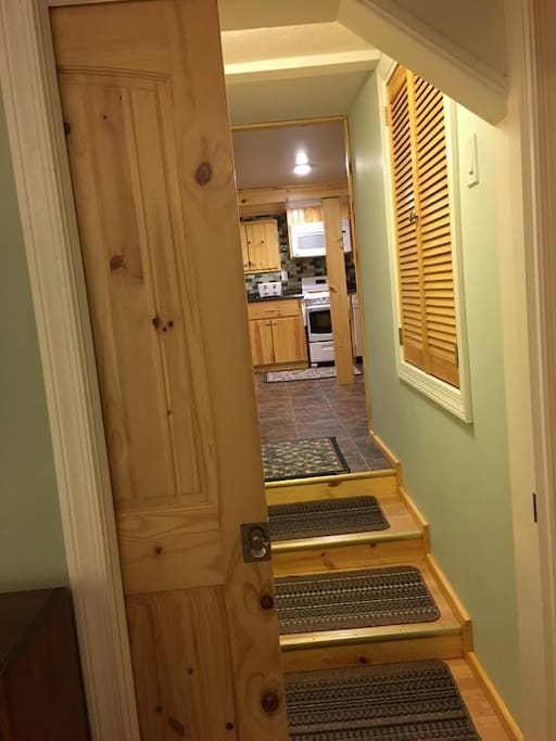 A pocket door separates the kitchen area from the living room and bedroom area.