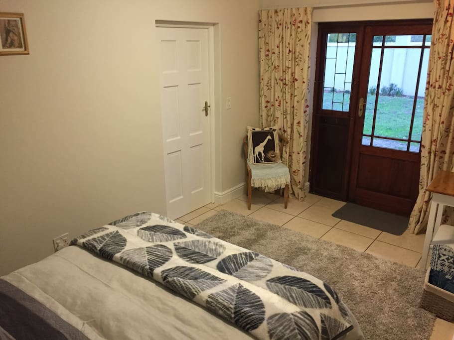Bedroom space with private access from the garden. Door is to shower ensuite