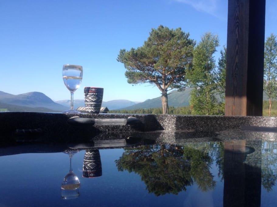 Utsikt fra boblebadet. The view from the outdoor spa.