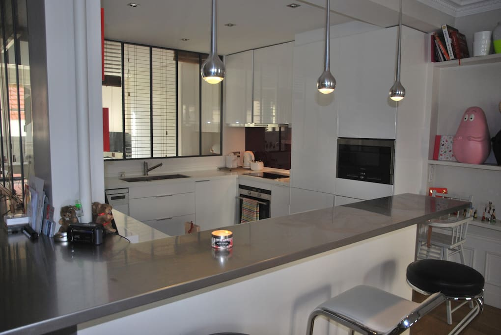Open kitchen with friendly bar....