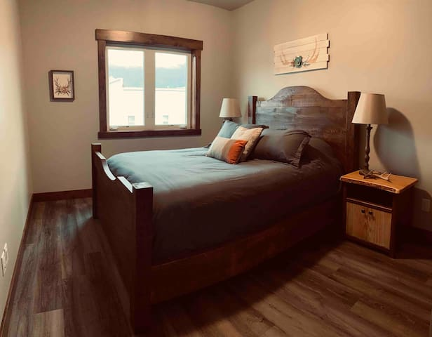 Antler room. Solid wood bed frames. Custom made in Montana. Alternative goose down comforter and 100% cotton sheets.