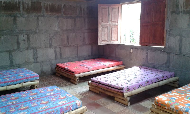 The dormitory - each bed has an electric outlet.