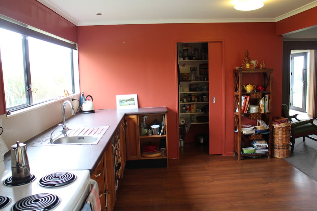 sunny kitchen, with lots of room to cook and fully equipped with herbs and spices!