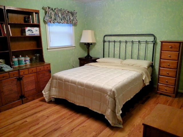 Smaller bedroom with a queen size bed. A folding bed (single size) kept in the closet.