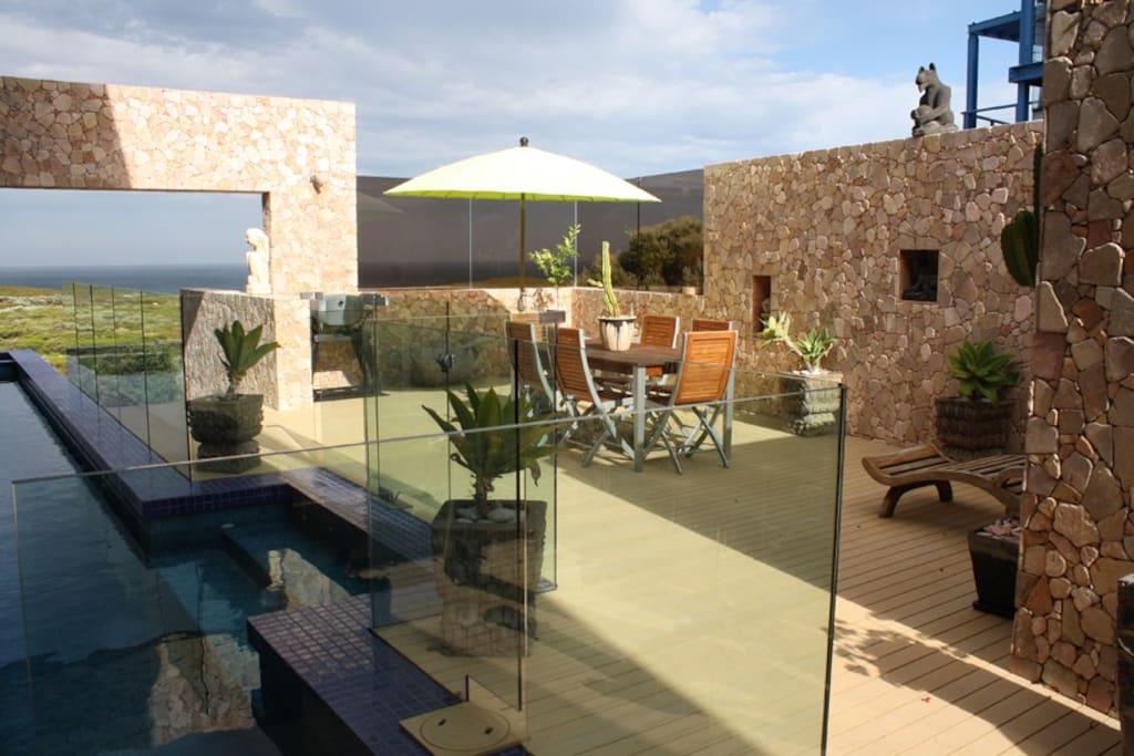 Al fresco area by the outdoor solar heated pool...