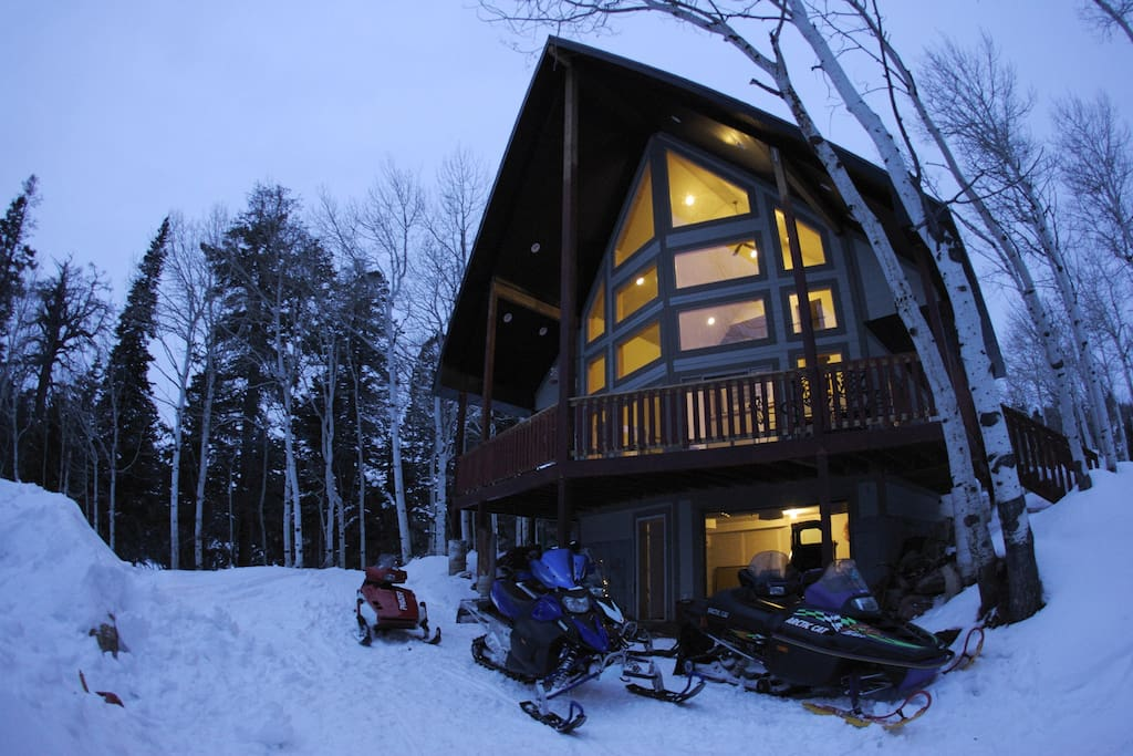 The front of the cabin features a covered, wrap around porch that overlooks a terrific view.