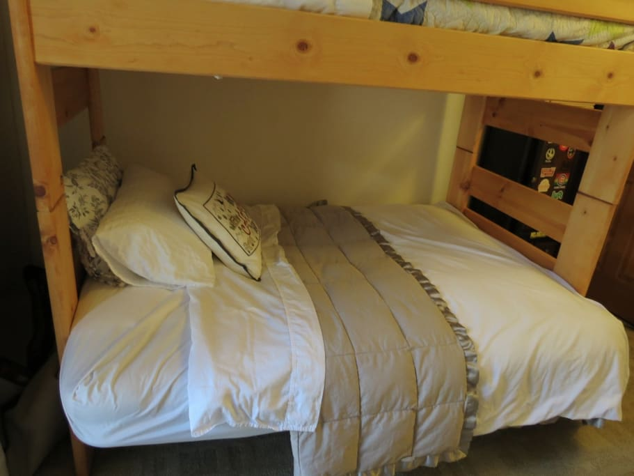 Our bunk bed is a futon on bottom and single bed on top. Don't fret...the futon/feather bed is super comfy!