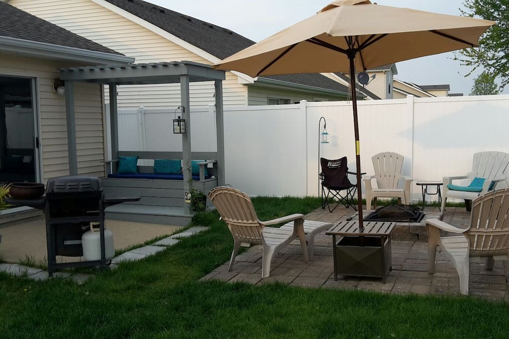 Private patio with fire pit and propane grill