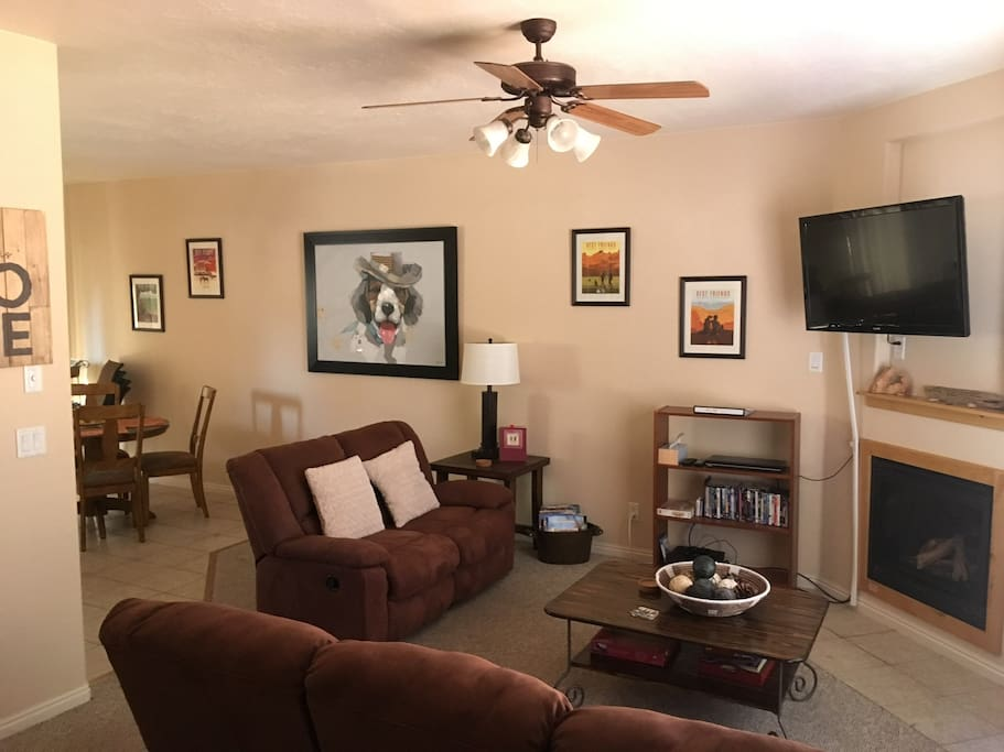 Living area with cozy gas fireplace and original artwork