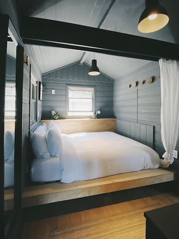 Queen-sized floating bed nook with privacy curtain