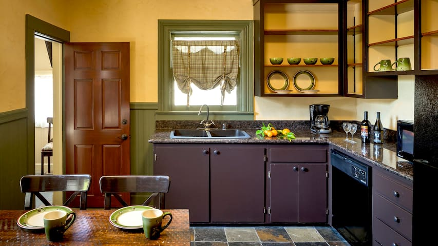 beautiful eat-in kitchen with hot plate, small fridge, sink and dishwasher