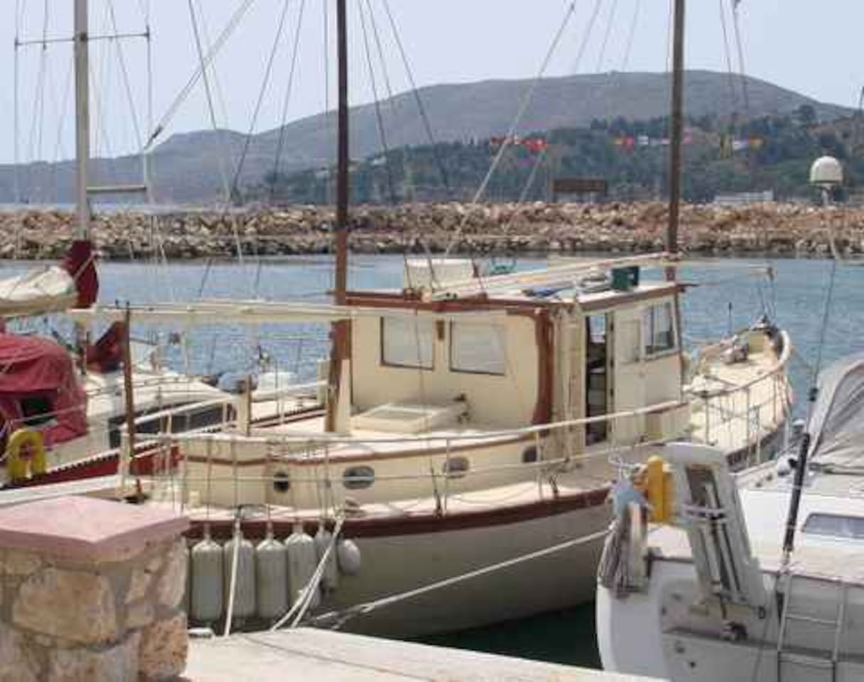 Trica, moored in Leros Marina. She has shade cover in the summer!