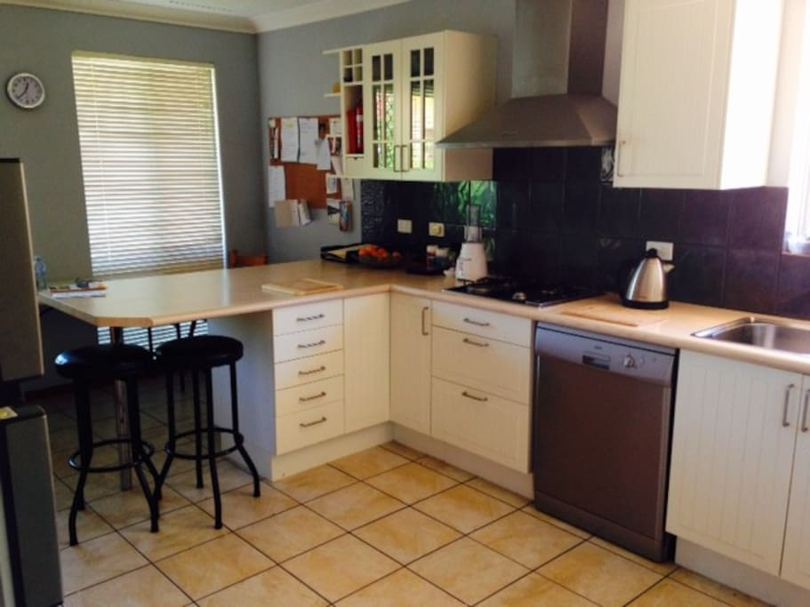Spacious kitchen with dishwasher and microwave