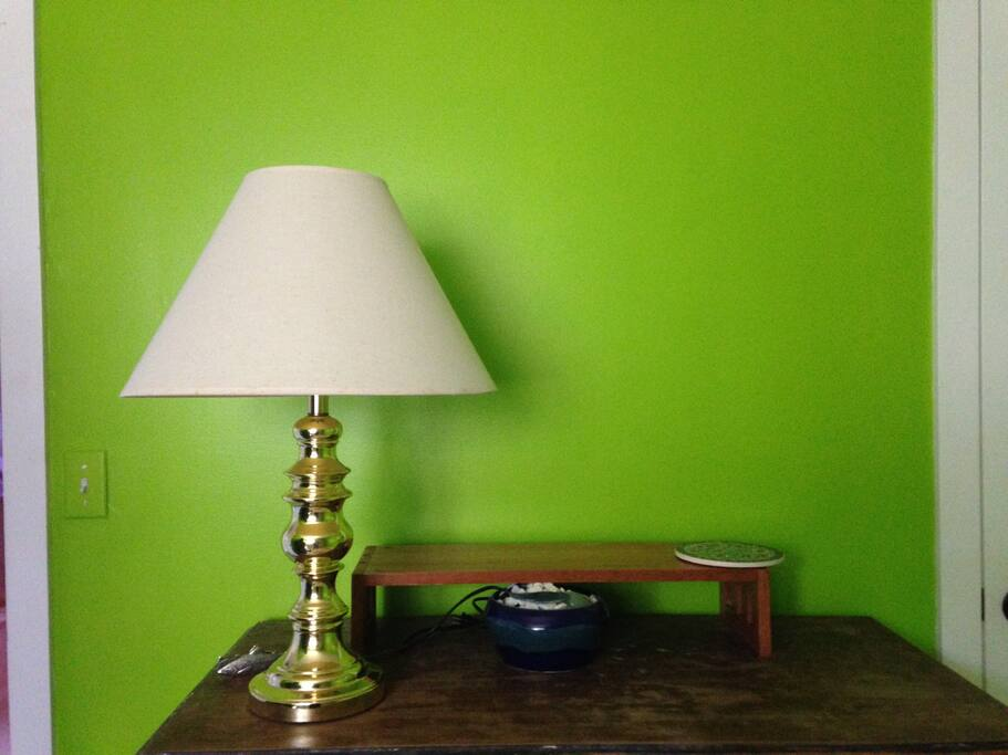 "Our guest room is a vibrant green and several plants add to the ""greenery""."