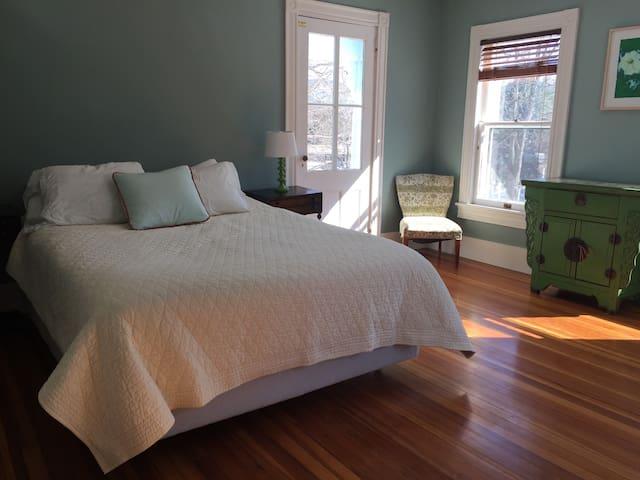 2nd floor queen bedroom with door to upper porch.