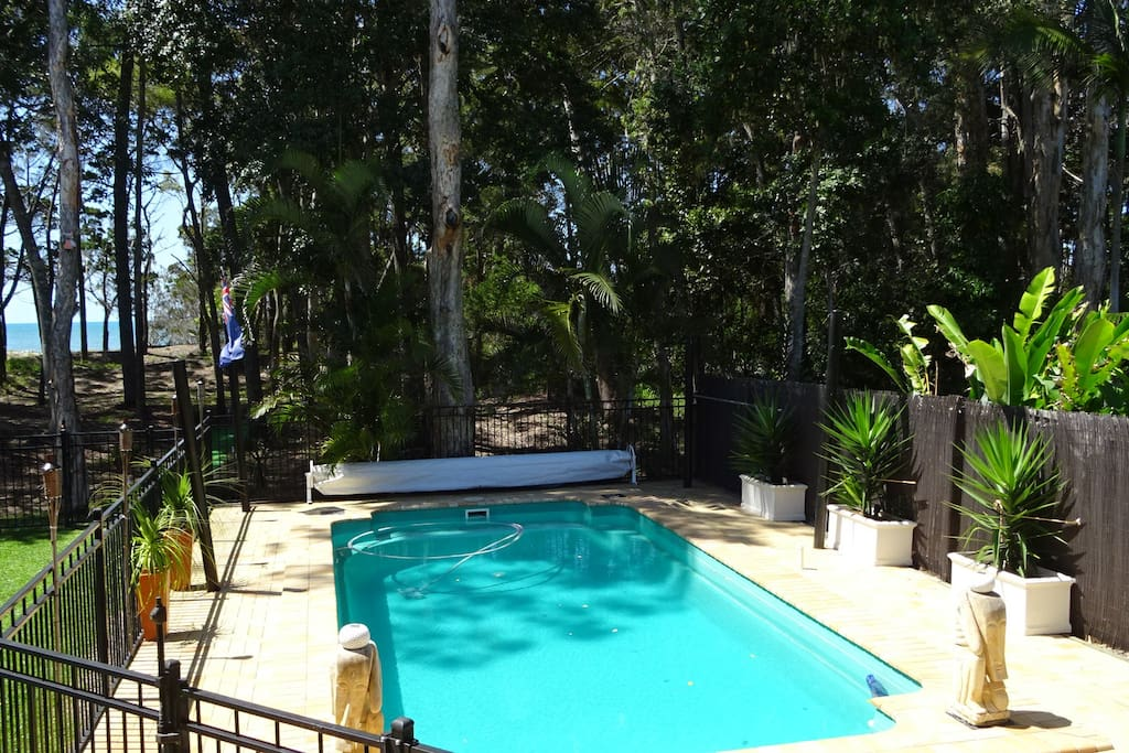 Looking out over the pool to beautiful, secluded Toogoom Beach.