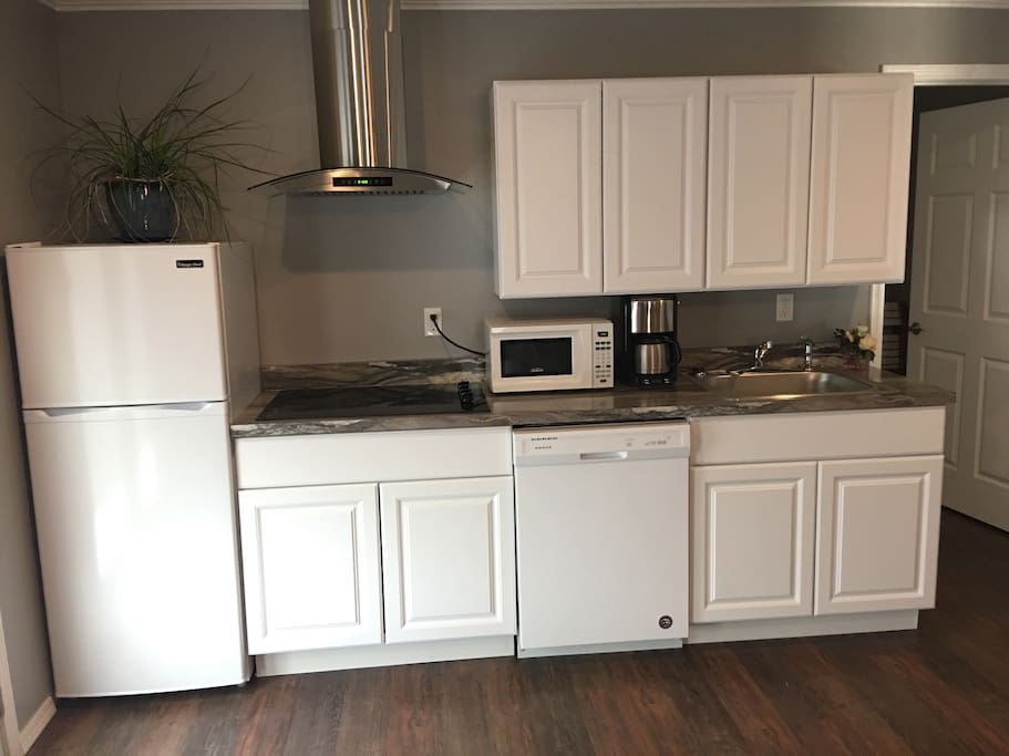 Nicely equipped kitchen with cook top, microwave, toaster oven and more