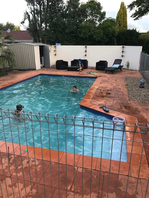 Pool in back yard. Fully fenced. Pool toys and outdoor furniture.