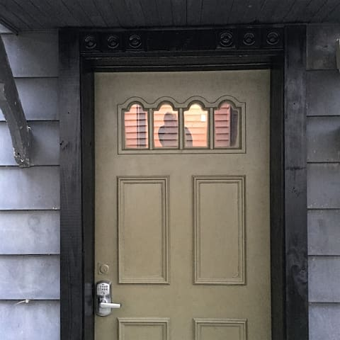 communal main entrance on side. custom keypad code. no keys to worry about - same on your apartment door too !