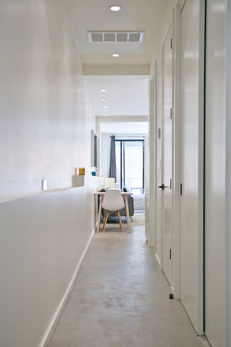 Enter to a long hallway to the open space, closet, bathroom, and washer/dryer to your left down hallways