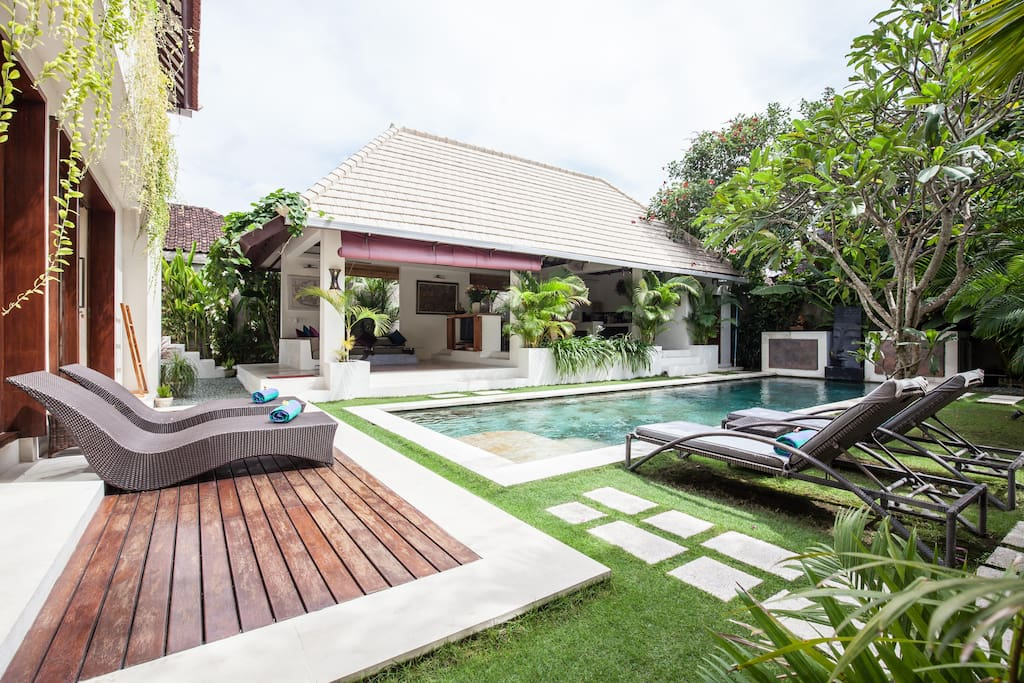 view across the deck and pool to the living Pavillion.
