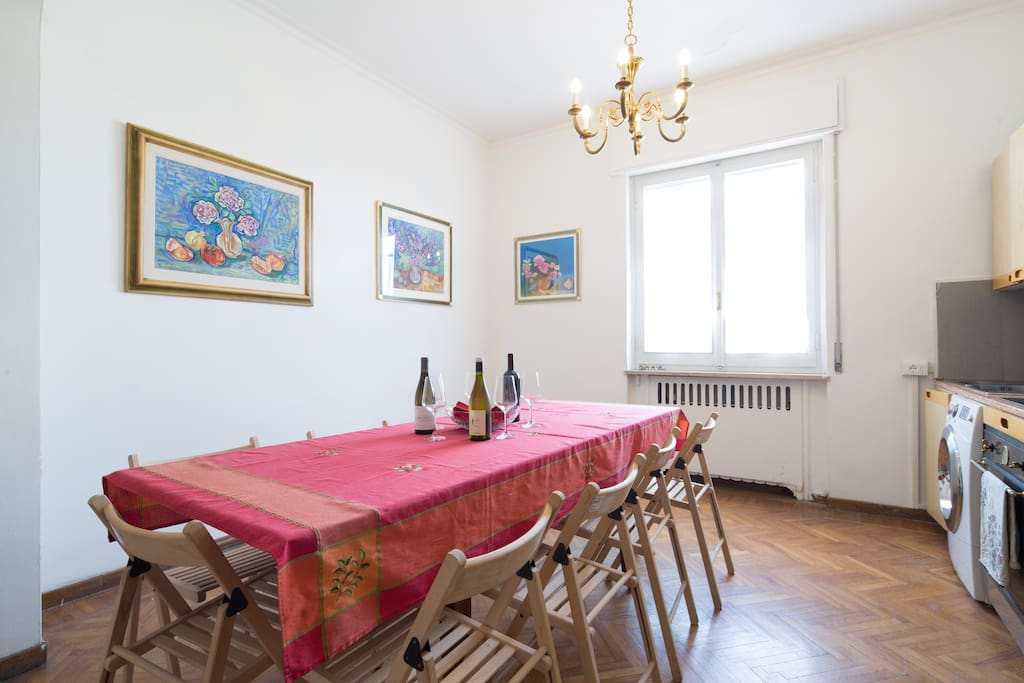 Kitchen with large table for gatherings.