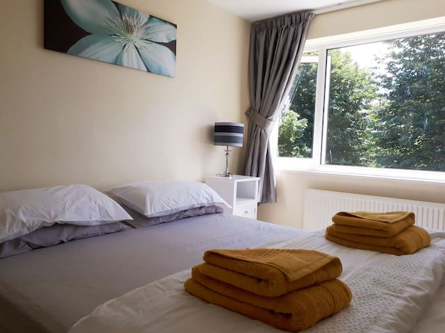 Bright double bedroom with vanity unit