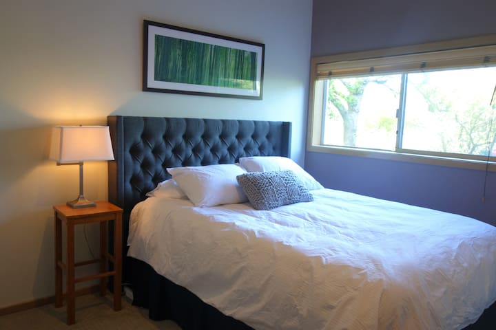Bedroom with queen bed and peaceful garden view.  All linens are washed with perfume-free and dye-free detergent.