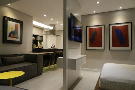 Futuristic apartment with gourmet kitchen equipped