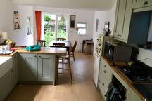 Our light and spacious new kitchen, which you are welcome to use!