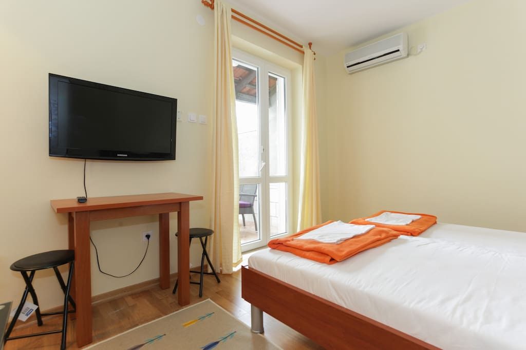 Room with bed which we can connected or separate, very well working air-conditioner, Flat TV with DVD