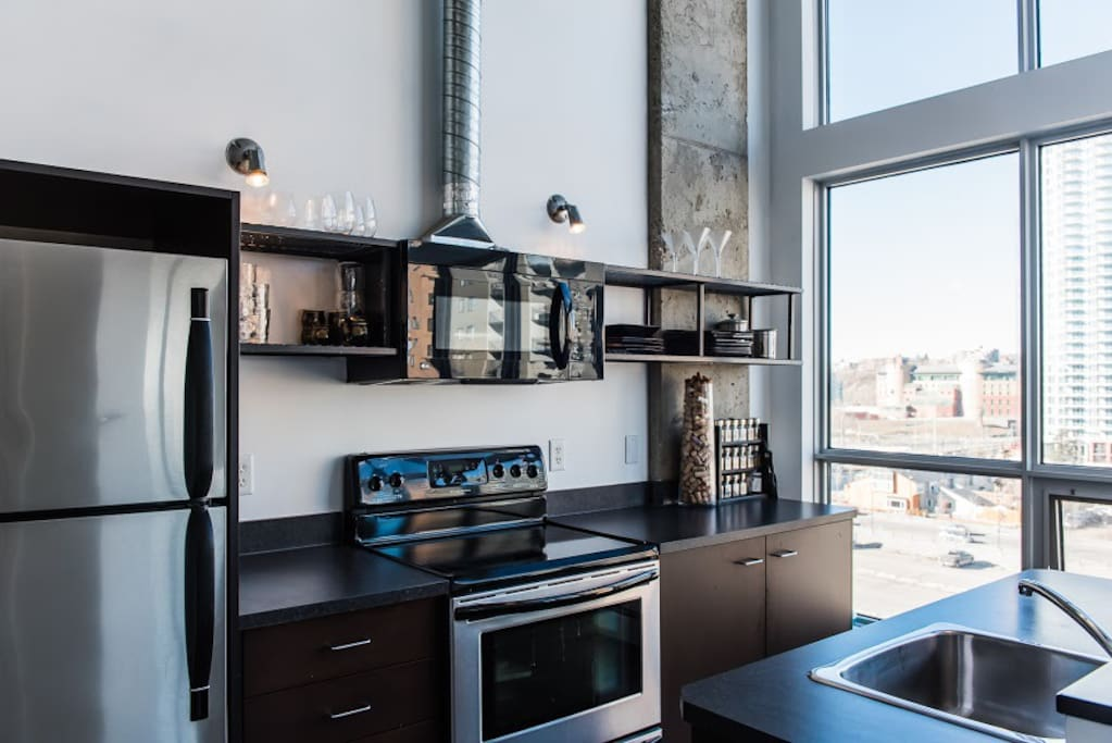 Enjoy cooking in your modern kitchen with a city view!