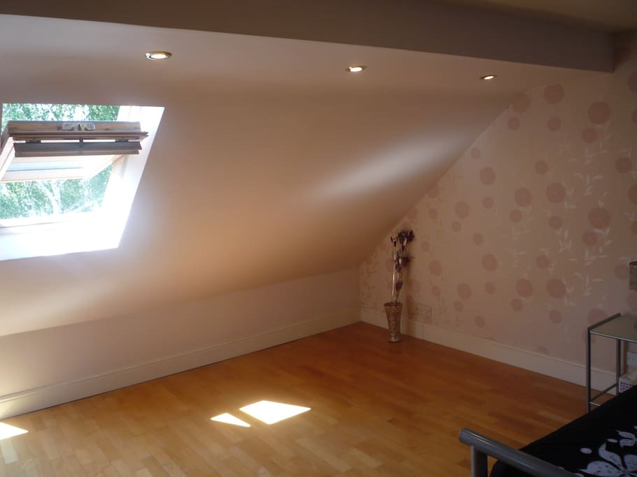 Double bedroom at loft level, window to front aspect