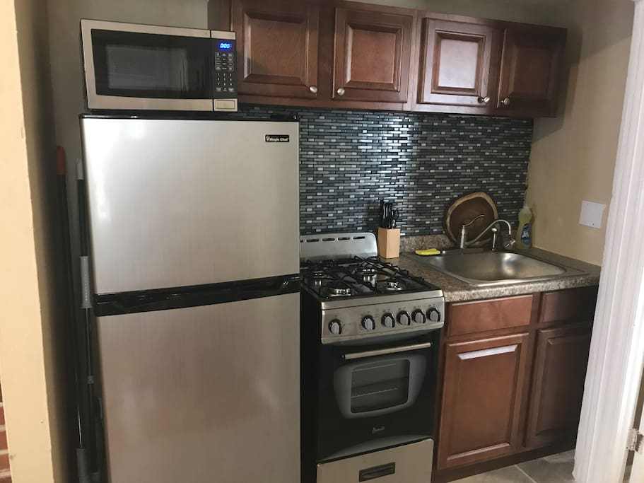 Newly Renovated kitchen, with new Fridge, Microwave, Stove, Sink and Cabinets