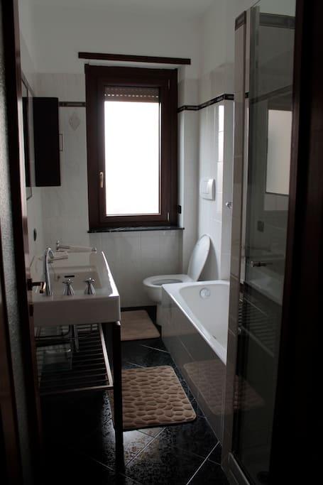 Bathroom with double glazed windows, bath and shower.