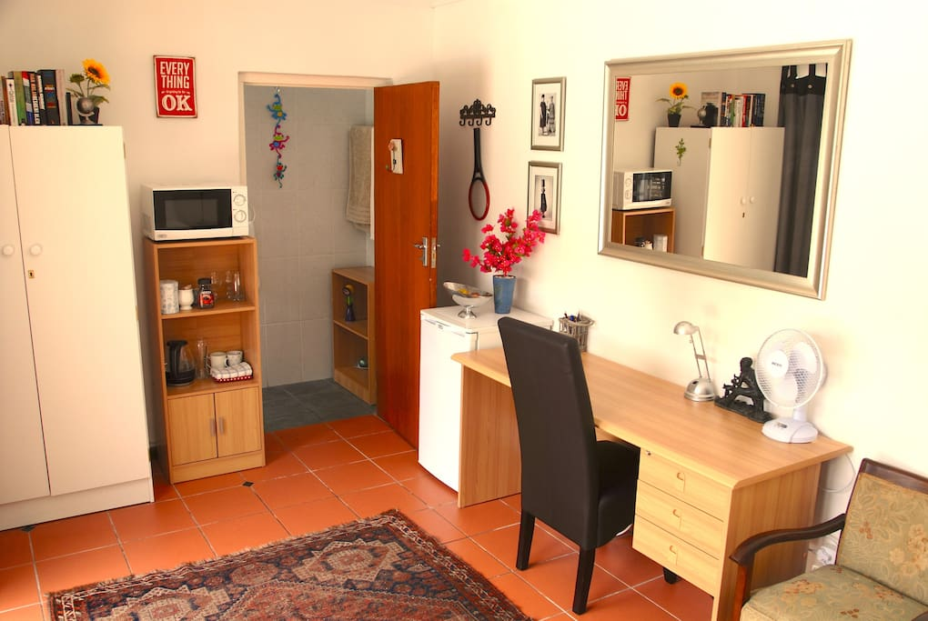 Inside the room - it comes with an ensuite bathroom. There is a microwave, fridge, kettle, hair dryer, good wireless internet, fan, heater and a library of books on Africa.