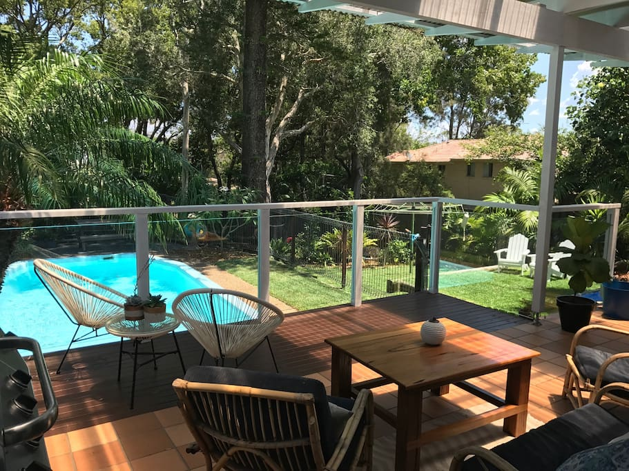 Huge entertaining deck overlooking the pool and large yard