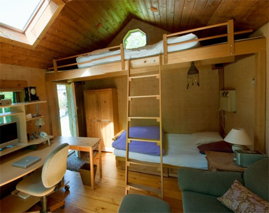 Room interior, bed with loft above.