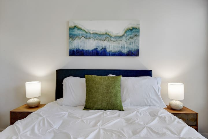 Soft pillows, beautiful lamp, and wall decor